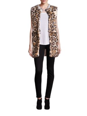 """Image of Lush rabbit fur vest with striking leopard spots. Roundneck. Sleeveless. Concealed front closure. About 30"""" from shoulder to hem. Fur type: Dyed rabbit. Fur origin: China. Dry clean by fur specialist. Imported."""