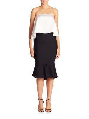 """Image of Two-tone dress with ruffle popover bodice. Straight across neckline. Strapless. Popover bodice. Front slit. Concealed back zip. About 44"""" from top to hem. Rayon/nylon. Dry clean. Made in Italy. Model shown is 5'10"""" (177cm) wearing size Small."""
