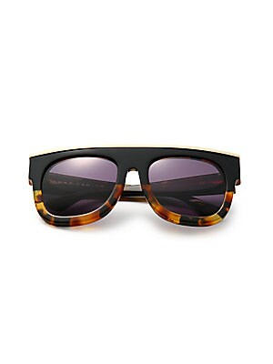 Image of Edgy tortoise shell frame with gleaming golden top bar 56mm lens width; 18mm bridge width; 135mm temple length 100% UV protection Cleaning cloth included Acetate/brass Made in Italy. Soft Accessorie - Sunglasses. Dax Gabler. Color: Black Tortoise.