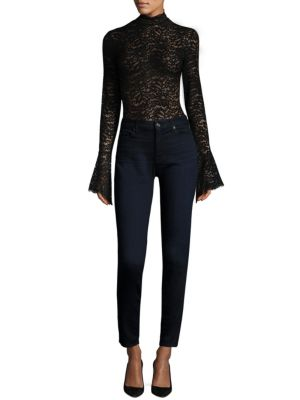 """Image of Ruffle cuffs update feminine lace bodysuit. Mockneck. Long sleeves with ruffle cuffs. Scalloped at neck and cuffs. Bottom snap closures. About 29"""" from shoulder to hem. Nylon/cotton/elastane. Hand wash. Made in USA of imported fabric."""