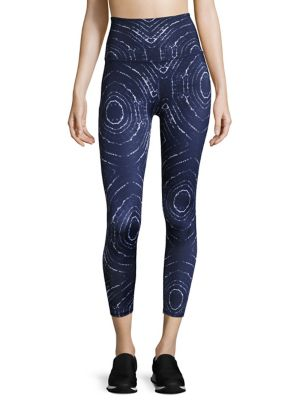 "Image of Comfy leggings highlighted with allover abstract print. Elasticized waist. Pull-on style. Rise, about 6"".Inseam, about 28"".Leg opening, about 4"".Polyester/lycra. Machine wash. Made in USA. Model shown is 5'10"" (177cm) wearing US size Small."
