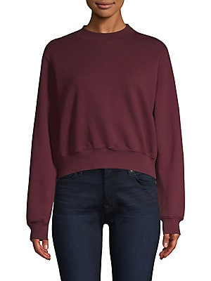 "Image of Fashionable cropped silhouette with distressed details Crewneck Long sleeves with ribbed cuffs Pullover style Ribbed hem About 19"" from shoulder to hem Cotton Machine wash Made in USA Model shown is 5'10"" (177cm) wearing US size Small. Contemporary Sp - C"
