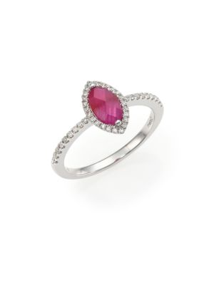 Image of Marquise-cut ruby with diamond halo on pave band. Diamonds, 0.25 tcw. Ruby.14k white goldtone. Imported.