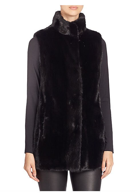 """Image of EXCLUSIVELY AT SAKS FIFTH AVENUE. Long sleeveless staple in plush mink fur. Stand collar. Sleeveless. Concealed front hook-and-eye closure. Lined. About 30"""" from shoulder to hem. Fur type: Dyed mink. Fur origin: Finland. Dry clean by fur specialist. Impor"""