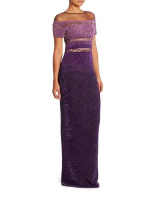 "Image of Radiant sequin embellished gown with a semi-sheer panel. Illusion neckline. Short sleeves. Concealed back zip. Back slit. Lined. About 60"" from shoulder to hem. Polyester. Dry clean. Made in Italy. Model shown is 5'10"" (177cm) wearing US size 2."