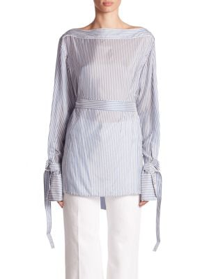 "Image of Belted cuffs and waist updated striped classic. Bateau neckline. Long sleeve with self-tie belted cuffs. Self-tie belt at waist. Yoked back. Pullover style. About 30"" from shoulder to hem. Cupro. Dry clean. Made in Italy. Model shown is 5'10"" (177cm) wear"