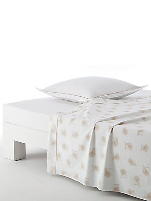 "Image of Add a floral touch to your bedroom décor with this flat sheet, which is highlighted by subtle leaf prints and matching bourdon stitch detailing for a whimsical appeal. 200 thread count Combed cotton 95"" W X 122"" H Machine wash Made in Spain. Gifts - Bed A"