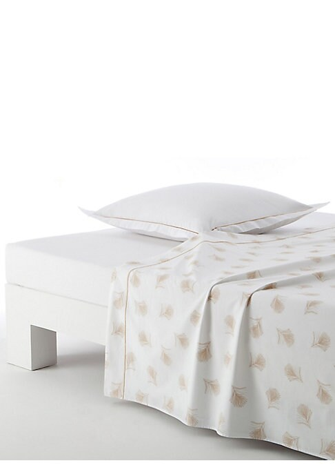 """Image of Add a floral touch to your bedroom decor with this flat sheet, which is highlighted by subtle leaf prints and matching bourdon stitch detailing for a whimsical appeal.200 thread count. Combed cotton.95"""" W X 122"""" H.Machine wash. Made in Spain."""