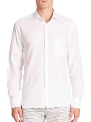 """Image of Breathable cotton essential with textured dots finish. Spread collar. Front button closure. Chest patch pocket. Long sleeves with buttoned barrel cuffs. Back yoke. Shirttail hem. About 31"""" from shoulder to hem. Cotton. Machine wash. Made in Italy."""