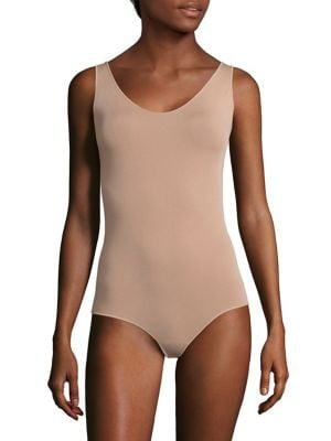 "Image of Scoopneck bodysuit in smooth, seamless construction. Scoopneck. Sleeveless. Thong back. About 28"" from shoulder to hem. Modal/nylon/elastane. Machine wash. Imported."