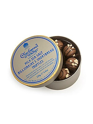 Image of Covered with luscious dark chocolate and filled with rich caramel, these delectable truffles are packed in a convenient circle-shaped paper box, making it an elegant gifting option for any occasion. Includes 16 truffles Ingredients: milk chocolate, sugar