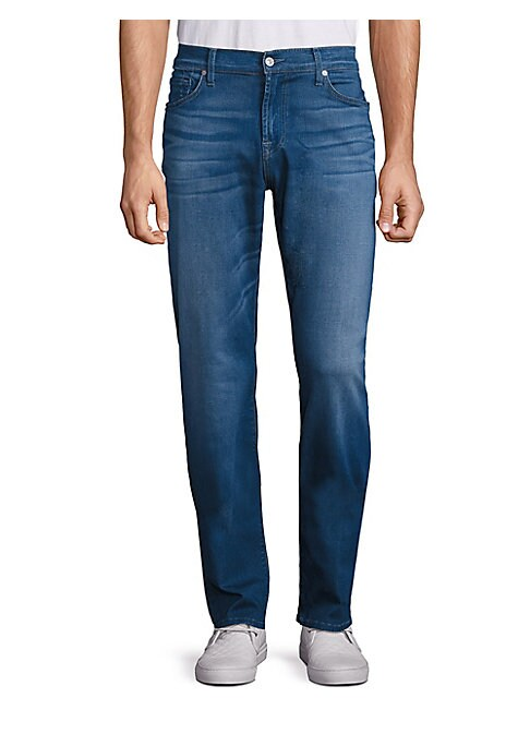 """Image of A pair of slim straight fit jeans in subtle fading and whisker details. Belt loops. Five-pocket style. Zip fly with button closure. Rise, about 10"""".Inseam, about 33.5"""".Leg opening, about 15"""".Modal/cotton/polyester/spandex. Machine wash. Imported."""