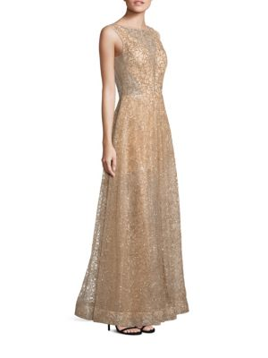 """Image of Sparkling sequin gown in elegant floral motif. Illusion neckline. Sleeveless. Concealed back zip. Seamed waist. Flared skirt. Semi-sheer back. Lined. About 61"""" from shoulder to hem. Nylon. Spot clean. Imported. Model shown is 5'10"""" (177cm) wearing US size"""