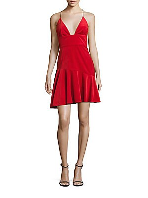 """Image of Lush velvet A-line dress with plunging neckline Deep V-neck Spaghetti straps Banded waist Ruffle hem Concealed back zip About 37"""" from shoulder to hem Polyester Dry clean Made in USA Model shown is 5'10"""" (177cm) wearing US size 4. Dress Collectio - Contem"""