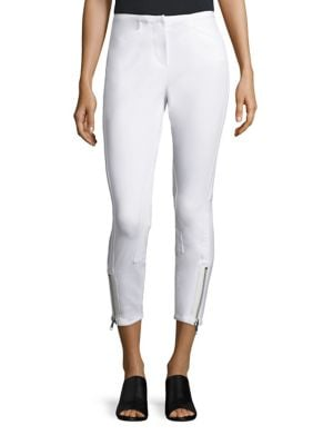 "Image of Ankle-length pants in a sleek silhouette. Banded waist. Zip fly with hook-and-eye closure. Side slash pockets. Zip detail at hem. Rise, about 11"".Inseam, about 25"".Cotton/modal/elastane. Dry clean. Imported. Model shown is 5'10"" (177cm) wearing US size 4."