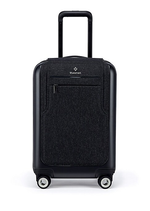 "Image of A modern carry-on ideal for weekend travels. Retractable top handle. Remote operated zipper closure. One zip pocket outside. One outside compartment. Interior 3 zipper pockets. Criss-cross straps inside.360 degree wheels a leg.14"" W x 22"" H x 9"" D.Polycar"