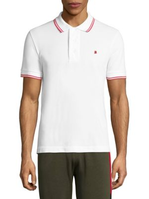 Image of Classic cotton pique polo tipped with double stripes. Polo collar. Short sleeves. Button placket. Cotton. Dry clean. Imported.