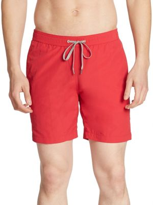 "Image of EXCLUSIVELY OURS. Comfy swim staple crafted in a solid finish. Elasticized waistband with drawstring closure. Slash pockets. Back zip welt pocket. Rise, about 4"".Inseam, about 13"".Nylon. Machine wash. Made in Italy."