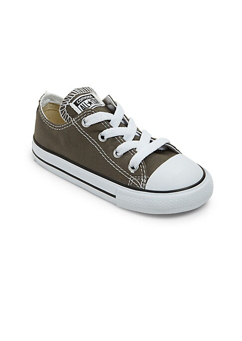 Image of Classically cool low-top sneaker cast in casual canvas. Canvas upper. Round toe. Lace-up vamp. Cotton-canvas lining. Rubber sole. Imported.