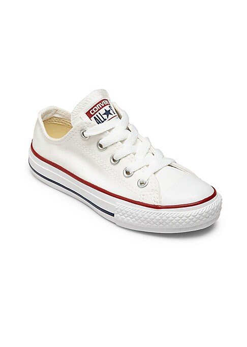 Image of Classic, forever-cool canvas low-top sneakers. Cap toe. Lace-up closure. Canvas upper. Textile lining. Rubber sole. Imported.