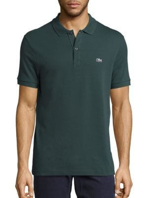 """Image of Solid hued polo with tri-color croc applique. Polo collar. Two-button placket. Short sleeves with ribbed armbands. Tri-color embroidered croc applique on left chest. About 29"""" from shoulder to hem. Cotton. Machine wash. Imported."""