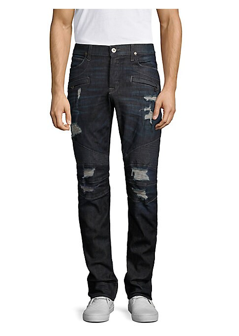 """Image of Skinny fit jean with destruction and moto detail at knee. Front zipper pockets. Rise, about 10"""".Leg opening, about 13"""".Inseam, about 34"""".Cotton/elastane. Machine wash. Imported."""