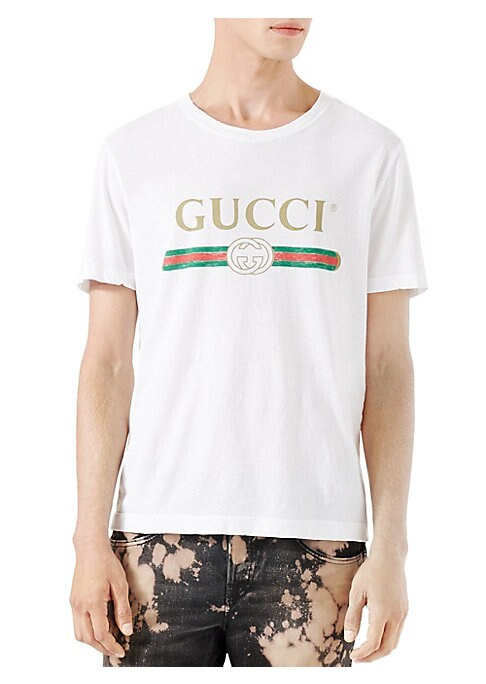 """Image of Crewneck. Short sleeves. Gucci vintage logo. Oversize fit. Washed cotton jersey. About 26"""" from shoulder to hem.100% cotton. Dry clean. Made in Italy."""