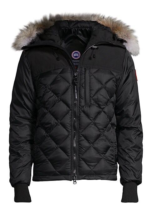 """Image of Appealing diamond quilted coat in low-waist cut. Attached coyote fur lined hood. Front zipper closure. Napoleon pocket with zipper closure. Long sleeves with ribbed cuffs. Two fleece-lined handwarmer pockets. About 29"""" from shoulder to hem. Nylon. Fill: W"""