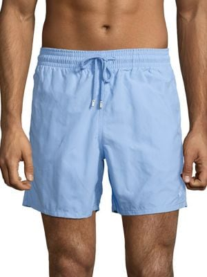 "Image of Solid water reactive shorts for ultimate comfort. Elasticized waistband with adjustable drawstring. Slash pockets. Back flap pocket. Rise, about 16"".Polyamide. Machine wash. Imported."