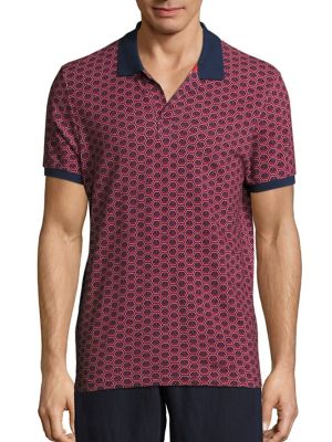 Image of Contrast trimmed polo showcasing anchor prints. Polo collar. Short sleeves. Pullover style. Cotton. Machine wash. Imported.