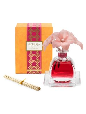Image of Agraria AirEssence diffuses scent through a trio of sola flowers, a natural and environmentally friendly material. As the fragrant essential oils are absorbed through the cotton wick, the petals come alive with the color of the oil and the scent begins to