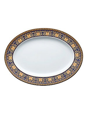 """Image of The decorative platter makes for an ideal table setting during gathering. This oval platter features ethnic patterns all along the rim. Diameter, 13.5"""" Porcelain Dishwasher safe Imported. Gifts - Tabletop. Versace. Color: Blue."""