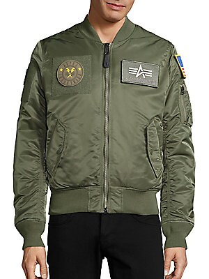 Image of Functional bomber jacket offers warmth and comfort Ribbed baseball collar Front zip closure Long sleeves with ribbed cuffs Side flap pockets Left sleeve zip pocket Ribbed hem Nylon Dry clean Imported. Men Adv Contemp - Contemporary Outerwear > Saks Fifth