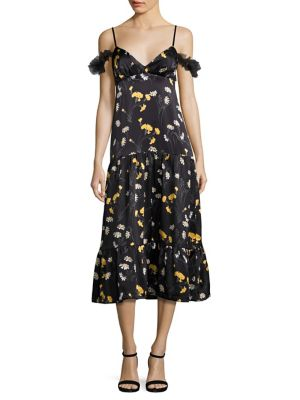 "Image of Draped tulle sleeves elevate daisy-print dress. Deep V-neck and back. Shoulder cutouts. Adjustable spaghetti straps. Ruffled tulle short sleeves. Seamed Empire waist. Ruffled hem. Concealed back zip. About 48"" from shoulder to hem. Polyamide. Dry clean. I"