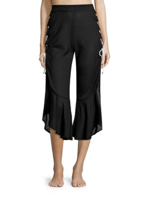Image of Stretch ruffle lace-up jersey pant cut for a relaxed fit with an asymmetric cropped hem. Elasticized waistband. Pull-on style. Cotton. Hand wash. Made in USA.