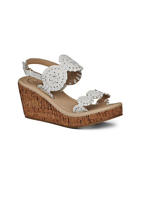"Image of Cork wedge sandal with whipstitch medallion straps. Leather upper. Adjustable grip-tape slingback strap. Cork wedge heel, 2.25"" (60mm).Cork platform, 1"" (25mm).Compares to a 2"" heel (50mm).Open toe. Leather lining. Rubber sole. Imported."
