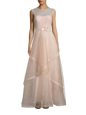 """Image of Romantic beaded ball gown with layered tulle skirt. Illusion neckline. Cap sleeves. Concealed back zip with button closures. Embellished self-tie belt. Lined. About 63"""" from shoulder to hem. Polyester. Dry clean. Imported. Model shown is 5'10"""" (177cm) wea"""
