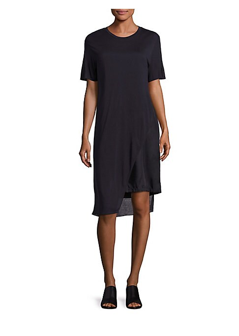 """Image of Unbalanced hem updates cotton T-shirt dress. Banded roundneck. Short sleeves. Asymmetrical hem. Pullover style. About 41"""" from shoulder to hem. Cotton. Dry clean. Imported. Model shown is 5'10"""" (177cm) wearing size Small."""