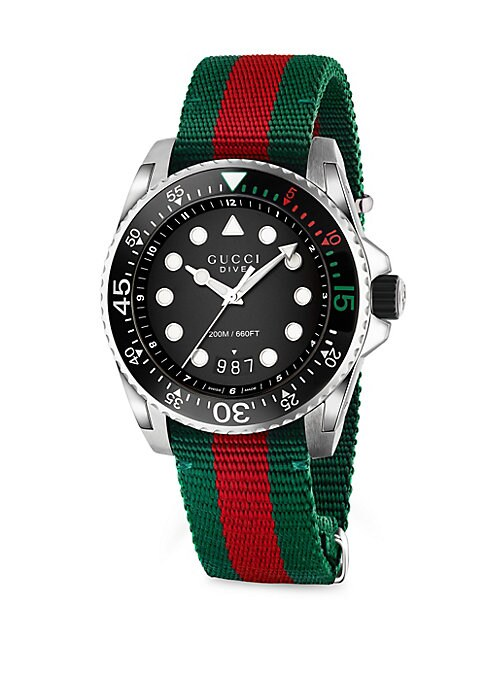 Image of From the Gucci Dive Collection. Stainless steel watch featuring three-color strap. Water resistant to 20 ATM. Round stainless steel case. Unidirectional rotating bezel. Black analog dial. Date display at 6 o'clock. Web nylon strap. Deployant ardillon buck