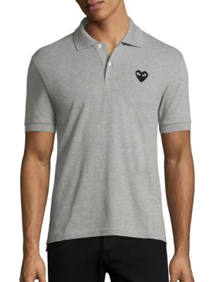 Image of Soft pique polo with signature logo accent on chest. Polo collar. Two-button placket. Short sleeves with ribbed armbands. Tennis tail hem. Cotton. Dry clean. Imported.