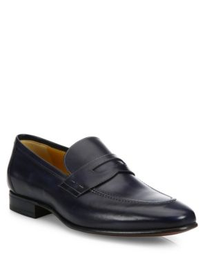 Image of Dapper slip-on shoes crafted from smooth leather. Leather upper. Almond toe. Slip-on style. Leather lining and sole. Includes dust bag. Made in Italy.