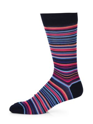 Image of Pima cotton socks exhibiting multicolor stripes. Pima cotton. Machine wash. Made in Italy. Comes in a whisky themed box.