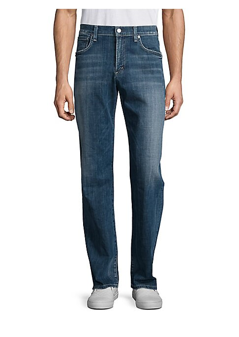 "Image of Faded jeans stylized with faded whiskers. Belt loops. Zip fly with button closure. Five-pocket style. Rise, about 10"".Inseam, about 34"" .Cotton/elastane. Machine wash. Made in USA."