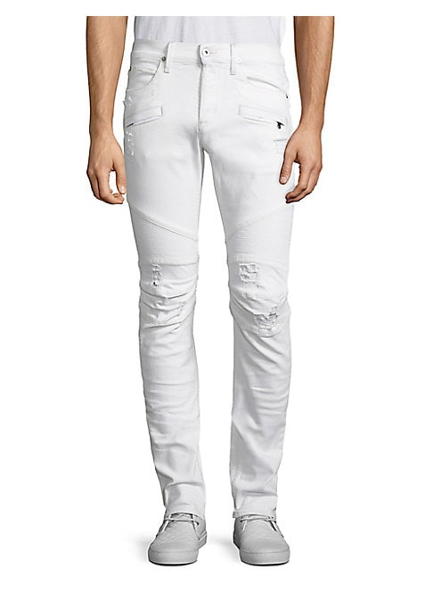 """Image of Skinny fit jean with moto detail at knee and light destruction. Front zip pockets. Rise, about 10"""".Leg opening, about 13"""".Inseam, about 34"""".Cotton/polyester/elastane. Machine wash. Imported."""