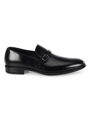 Image of Buckle strap accent highlights these leather loafers. Leather upper. Almond toe. Slip-on style. Leather lining and sole. Made in Italy.