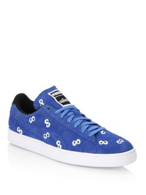 Image of Striking prints on rugged suede sneakers. Suede upper. Lace up vamp. Suede lining. Rubber sole. Imported.