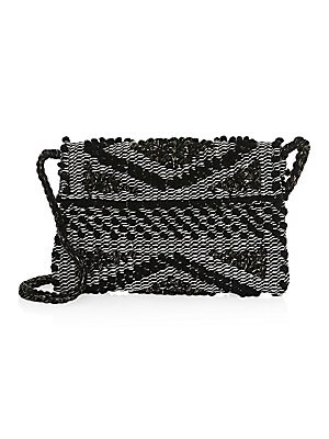 "Image of Beautifully textured crochet clutch with braided strap is vintage-inspired Strap drop, about 18"" Magnetic-flap closure Interior flap pocket 11""W x 9""H x 1""D Organic cotton Made in Italy. Handbags - Contemporary Handbags. Antonello Tedde. Color: Coral Ivor"
