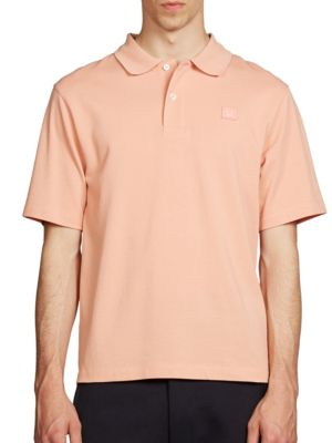 Image of Comfy polo in solid finish offers style and comfort. Polo collar. Two button placket. Short sleeves. Cotton. Hand wash. Made in Portugal.