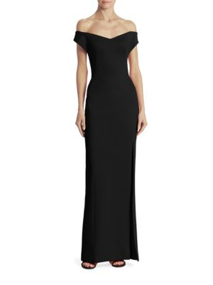 "Image of Off the shoulder design in a fitted silhouette. Off the shoulder.V-neck. Front slit. Concealed back zip closure. About 60"" from shoulder to hem. Viscose/polyamide/elastane. Dry clean. Made in USA. Model shown is 5'10"" (177cm) and wearing US size 4."