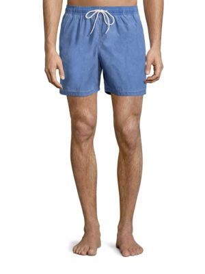 "Image of Relaxed solid swim shorts offer comfortable wear. Elasticized waistband with drawstring closure. Side pockets. Back flap pocket. Inseam, about 6"".Cotton/polyamide. Machine wash. Made in Portugal."